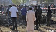 Bomb squad experts and security personnel inspecting bike wreckages at a scene of multiple bombings at the Kano Central Mosque November 28, 2014. Gunmen set off three bombs and opened fire on worshippers at the central mosque in north Nigeria's biggest city Kano, killing at least 35 people on Friday, witnesses and police said, in an attack that bore the hallmarks of Islamist Boko Haram militants. REUTERS/Stringer (NIGERIA - Tags: CIVIL UNREST)