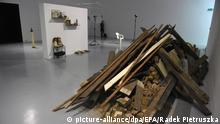 epa04507222 Piling planks, stones and ground are on display as part of the 'Unsubscribe' exhibition by German contemporary artist Gregor Schneider at the Zacheta National Gallery of Art in Warsaw, Poland, 28 November 2014. The exhibition shows contents and fragments of the demolished family house of the Third Reich propaganda minister Joseph Goebbels. Schneider's ambition is to destroy the different fragments of the house although treating the building as a silent witness to history. The exhibition runs from 29 November to 01 February 2015. EPA/RADEK PIETRUSZKA POLAND OUT