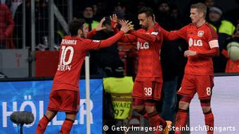 Karim Bellarabi celebrates with other Bayer Leverkusen players