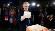 Presidential candidate for the ruling Frente Amplio party Tabare Vazquez casts his vote in a polling station in Montevideo, November 30, 2014. Uruguayans voted on Sunday for a new president with former leader Tabare Vazquez looking set to win comfortably, securing the ruling leftist coalition a third consecutive term and allowing it to roll out its pioneering marijuana law. Opinion polls give Vazquez, 74, who was president in 2005-2010, a 14 percentage point lead over Luis Lacalle Pou of the center-right National Party. REUTERS/Andres Stapff (URUGUAY - Tags: POLITICS ELECTIONS TPX IMAGES OF THE DAY)