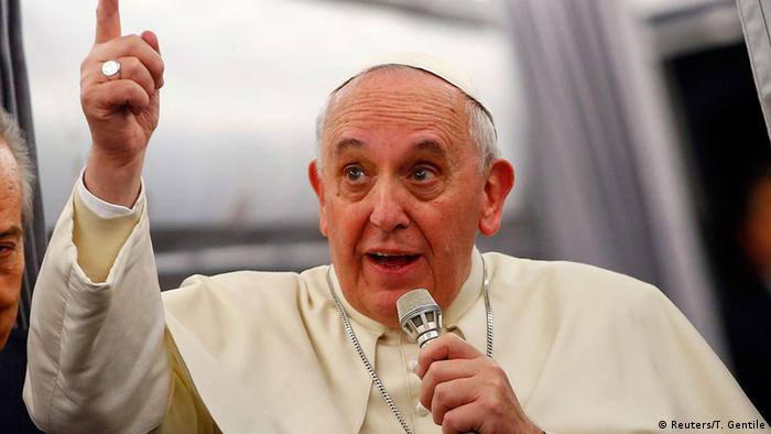 Pope Francis gestures as he speaks with journalists on the flight back from Istanbul to Rome, November 30, 2014. REUTERS/Tony Gentile (