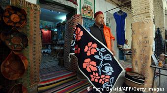 Man in shop in Tunisia selling carpets (Fethi Belaid/AFP/Getty Images)