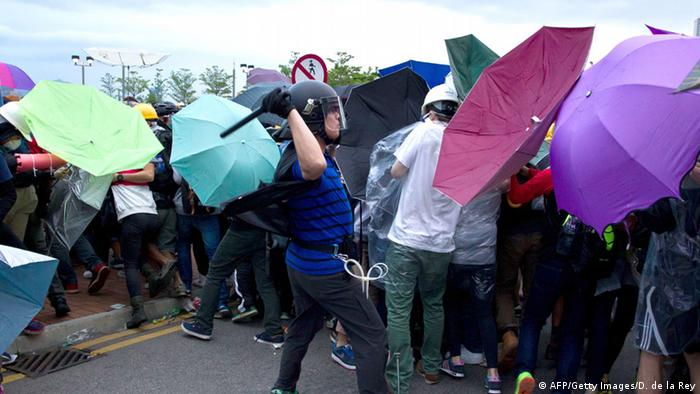 Hong Kong pro-democracy protesters clash with riot police in 201