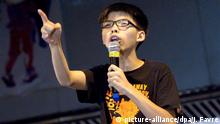 In this photograph taken on October 20, 2014, the leader of the student pro-democracy group Scholarism, Joshua Wong, speaks to demonstrators at a rally site in the Admiralty district of Hong Kong. Hong Kong pro-democracy protest leader Joshua Wong and two other leaders from the student group Scholarism announced December 1 that they have gone on hunger strike. Wong and female leaders Lo Yin-wai and Wong Tsz-yuet, 17, said they are fasting to attempt to force the Hong Kong government to respond to their demands for free elections in the semi-autonomous Chinese city in 2017. AFP PHOTO / DALE DE LA REY (Photo credit should read DALE de la REY/AFP/Getty Images)
