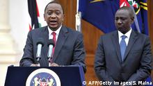 Kenyan President Uhuru Kenyatta delivers his state of the nation speech next to Vice President William Ruto (R) at the State House in Nairobi on December 2, 2014. Kenyatta warned Somalia's Shebab insurgents his security forces will 'intensify the war on terrorism' after a spate of killings in the country. Vowing to keep Kenyan troops inside Somalia for as long as it took to defeat the Al-Qaeda affiliated Shebab, Kenyatta said 'we will not flinch' from taking action against the Islamists. AFP PHOTO/SIMON MAINA (Photo credit should read SIMON MAINA/AFP/Getty Images)