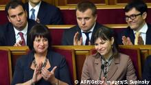 New Ukrainian Finance Minister Natalia Jaresko (L) applauds during a parliament session in Kiev on December 2, 2014. Ukraine's parliament confirmed US national Natalia Jaresko as finance minister while handing the economy portfolio to Lithuanian investment banker Aivaras Abromavicius in a new government designed to sweep out graft. AFP PHOTO/ SERGEI SUPINSKY (Photo credit should read SERGEI SUPINSKY/AFP/Getty Images)