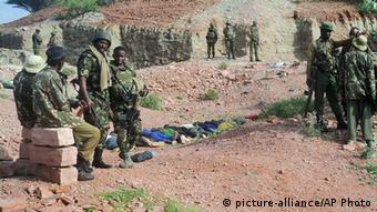Police stand by the bodies of people killed in Mandera in 2014