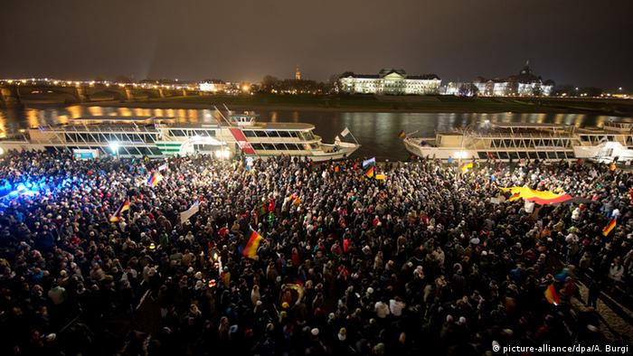 Thousands of right-wing extremists at a night-time rally on the Elbe river in Dresden.