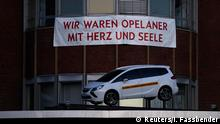 A banner we were Opel employees with heart and soul is seen in front of the Opel plant in Bochum November 25, 2014. European carmaker Opel will close its Bochum plant by year-end 2014. Picture taken on November 25. REUTERS/Ina Fassbender (GERMANY - Tags: TRANSPORT BUSINESS EMPLOYMENT)