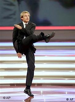 German national coach Jürgen Klinsmann kicking a ball at the World Cup draw in Leipzig, Dec. 9, 2005