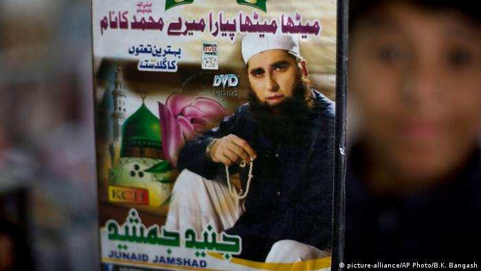 A vendor shows a DVD of Pakistan's Junaid Jamshed at a stall in Islamabad, Pakistan, Wednesday, Dec. 3, 2014 (AP Photo/B.K. Bangash)