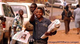 Paper boy in the streets of Rwanda (MARCO LONGARI/AFP).