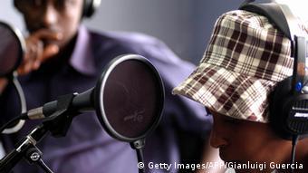 Two Rwandan radio journalists (Photo: GIANLUIGI GUERCIA/AFP/Getty Images)
