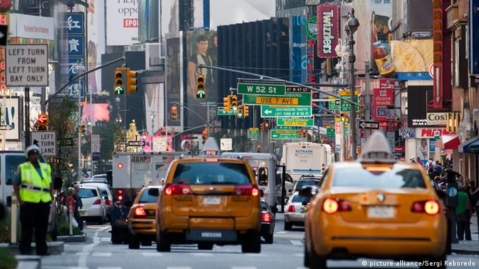 Crossing streets in Midtown West and Theater District on Broadway Street at the height of the 52