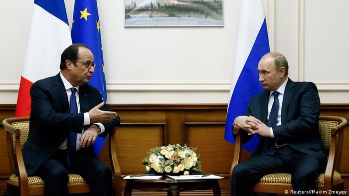 Володимир Путін (п) та Франсуа Олланд у Москві