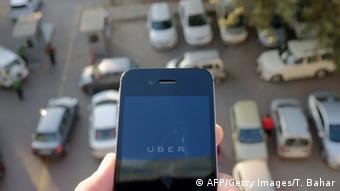 A smartphone opens the Uber app