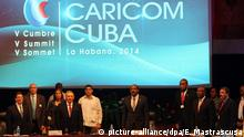 epa04520357 Cuban president Raul Castro (4-L) leads the opening of 5th Cuba-Caricom Summit held at Havana, Cuba, 08 December 2014. The summit gather heads of government and ministers of Foreign Affairs from Antigua and Barbuda, Bahamas, Barbados, Belice, Dominica, Granada, Guyana, Haiti, Jamaica, San Cristobal and Nieves, Santa Lucia, San Vicente and las Granadinas, Surinam, and Trinidad and Tobago. EPA/Ernesto Mastrascusa +++(c) dpa - Bildfunk+++