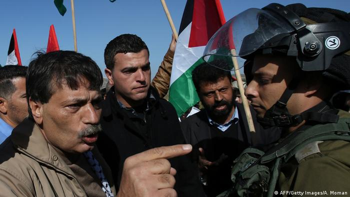 Palestinian official Ziad Abu Ein (L), in charge of the issue of Israeli settlements for the Palestinian Authority, argues with Israeli soldiers during a demonstration in the village of Turmus Aya near Ramallah, on December 10, 2014 (Photo: ABBAS MOMANI/AFP/Getty Images)