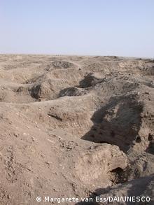 Holes dug into the ground at Isin in Iraq, Copyright: Margarete van Ess/DAI/UNESCO