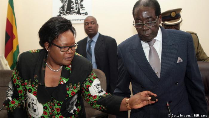Joice Mujuru and Robert Mugabe