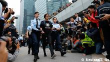Singer and actress Denise Ho is taken away by policewomen from an area previously blocked by pro-democracy supporters, outside the government headquarters in Hong Kong, December 11, 2014. Hong Kong authorities started on Thursday clearing the main pro-democracy protest site that has choked roads into the city's most economically and politically important district for more than two months as part of a campaign to demand free elections. REUTERS/Tyrone Siu (CHINA - Tags: CIVIL UNREST ENTERTAINMENT POLITICS BUSINESS TPX IMAGES OF THE DAY)