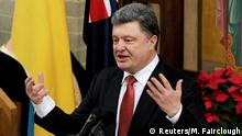 Ukraine's President Petro Poroshenko delivers remarks during an ecumenical church service held at Ukrainian Greek Eparchy of Saints Peter and Paul of Melbourne, December 11, 2014. Australia could export coal and uranium to Ukraine to help ease Kiev's over reliance on Russian energy exports, Australian Prime Minister Tony Abbott and Ukrainian President Petro Poroshenko said on Thursday. REUTERS/Mal Fairclough/Pool (AUSTRALIA - Tags: POLITICS RELIGION ENERGY)