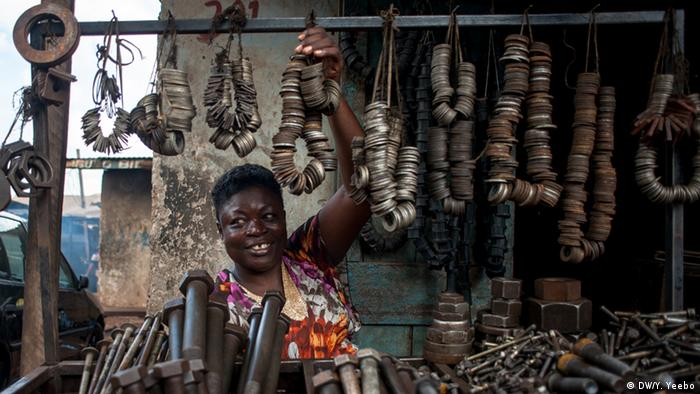 A woman selling nuts and bolts for cars, trucks and heavy machinery (Picture: Yepoka Yeebo, DW)