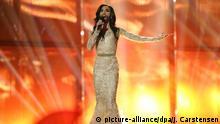 dpatopbilder Conchita Wurst representing Austria perform during the grand final of the 59th Eurovision Song Contest (ESC) in Copenhagen, Denmark, 10 May 2014. Photo: Joerg Carstensen/dpa (zu dpa Jahreswechselpaket 2014/2015) +++(c) dpa - Bildfunk+++
