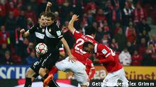 MAINZ, GERMANY - DECEMBER 13: Junior Diaz (front) of Mainz tries to score with a header against Daniel Schwaab of Stuttgart during the Bundesliga match between 1. FSV Mainz 05 and VfB Stuttgart at Coface Arena on December 13, 2014 in Mainz, Germany. (Photo by Alex Grimm/Bongarts/Getty Images)