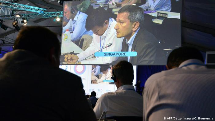 A Singaporean climate representative on a screen at the Lima climate conference