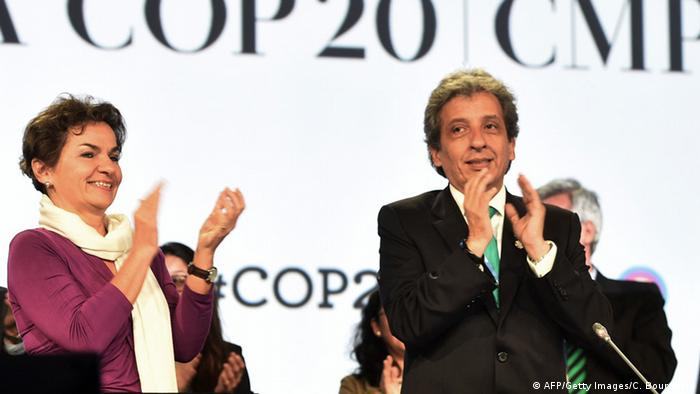 UNFCCC Executive Secretary Christiana Figueres and COP20 President and Peruvian Minister of Environment Manuel Pulgar celebrate the approval of the proposed compromise document handed out during the marathon UN talks in order to meet the final goal of the UN COP20 and CMP10 climate change conferences in Lima on December 14, 2014. CRIS BOURONCLE/AFP/Getty Images
