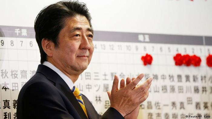 Japan's Prime Minister Shinzo Abe, who is also leader of the ruling Liberal Democratic Party (LDP), claps during an election night event at the LDP headquarters in Tokyo, December 14, 2014 (Photo: REUTERS/Issei Kato)