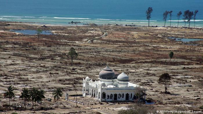 A Partly Damaged Mosque In The Lampuuk Coastal District Of Banda Aceh Where Surrounding Houses Were
