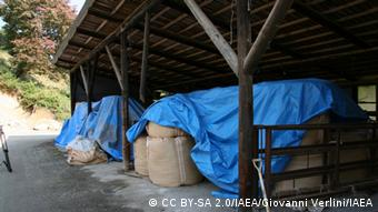 Photo: Sacks full of soil (Photo: Giovanni Verlini / IAEA https://www.flickr.com/photos/iaea_imagebank/623465)
