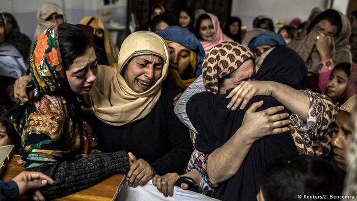 Women mourn their relative Mohammed Ali Khan, 15, a student who was killed during an attack by Taliban gunmen on the Army Public School, at his house in Peshawar December 16, 2014 (Photo: REUTERS/Zohra Bensemra)
