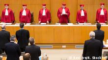 Ferdinand Kirchhof (4R), vice-president of Germany's Constitutional Court, announces the verdict on an inheritance law file at Germany's Federal Constitutional Court (Bundesverfassungsgericht) in Karlsruhe, December 17, 2014. Germany's Constitutional Court ruled on Wednesday that inheritance tax breaks granted to family-run companies were illegal in their current form, a verdict which could hurt many Mittelstand firms that form the backbone of the economy. The court gave lawmakers until mid-2016 to come up with a new law that ensures companies and individuals are treated equally. Until that time existing rules will apply, giving families who own firms time to resolve inheritance issues under the old regime. The case was brought by the Federal Fiscal Court, which challenged a 2009 law that allows ownership of family-run firms to be passed from one generation to the next tax free, provided the heirs keep it going for seven years and preserve jobs. Around 90 percent of German companies are family-run, employing more than half of the country's workforce and producing half of Germany's economic output. REUTERS/Ralf Stockhoff (GERMANY - Tags: CRIME LAW POLITICS BUSINESS)