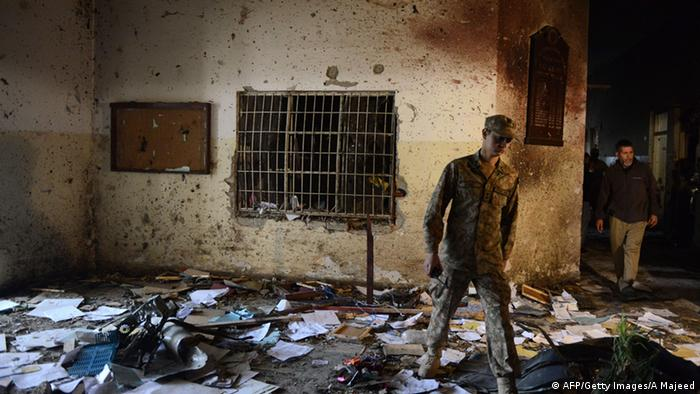 A Pakistani soldier walks amidst the debris in an army-run school a day after an attack by Taliban militants in Peshawar on December 17, 2014 (Photo: A Majeed/AFP/Getty Images)
