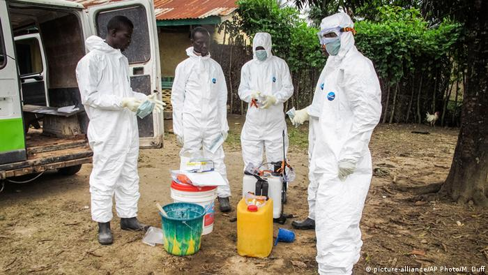 Four health workers in protective clothing