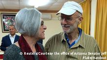 American aid worker Alan Gross (R) speaks with his wife Judy shortly before leaving Havana on December 17, 2014 in this photo tweeted by U.S. Sen. Jeff Flake (R-AZ). U.S. President Barack Obama was set to announce a shift in policy toward Cuba on Wednesday and the Associated Press reported the changes would include the opening of an embassy in Cuba and the start of talks to normalize relations. REUTERS/Courtesy the office of Arizona Senator Jeff Flake/Handout (CUBA - Tags: POLITICS) ATTENTION EDITORS - FOR EDITORIAL USE ONLY. NOT FOR SALE FOR MARKETING OR ADVERTISING CAMPAIGNS. THIS IMAGE HAS BEEN SUPPLIED BY A THIRD PARTY. THIS PICTURE WAS PROCESSED BY REUTERS TO ENHANCE QUALITY