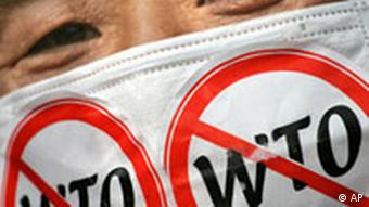 South Korean anti-WTO protesters wears a mask