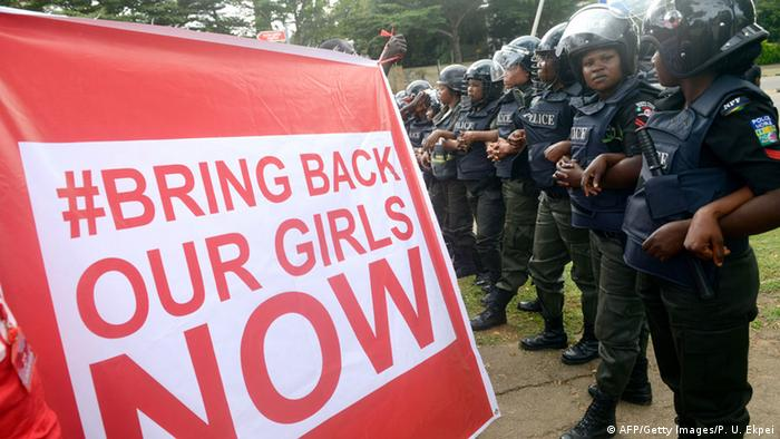 A banner with the hashtag #bringbackourgirls now
