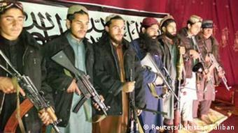 Militants, who the Pakistan Taliban say attacked the Army Public School in Pehawar on Tuesday, pose with weapons and Khalifa Omar Mansoor Hafzullah (C, in blue) at an unknown location in this undated handout picture released on December 17, 2014 (Photo: REUTERS/Pakistan Taliban/Handout)