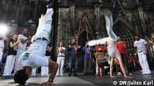 Capoeira Tänzern aus Köln, in Park und auch vor dem Dom Autor: Julien Karl (DW)