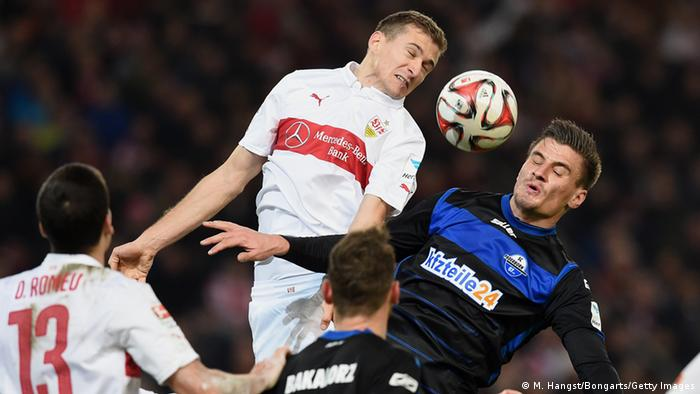 A Stuttgart and Paderborn player fight for a header