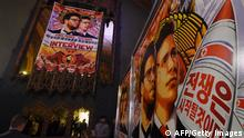 Movie posters for the premiere of the film The Interview at The Theatre at Ace Hotel in Los Angeles, California on December 11, 2014. The film, starring US actors Seth Rogen and James Franco, is a comedy about a CIA plot to assassinate its leader Kim Jong-Un, played by Randall Park. North Korea has vowed merciless retaliation against what it calls a wanton act of terror -- although it has denied involvement in a massive cyber attack on Sony Pictures, the studio behind the film. AFP PHOTO/STR (Photo credit should read -/AFP/Getty Images)