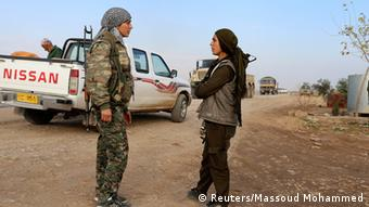 Kurdish People's Protection Units (YPG) and Kurdistan Workers Party (PKK) fighters man a checkpoint on a highway connecting the Iraqi-Syrian border town of Rabia and the town of Snuny north of Mount Sinjar December 20, 2014.
