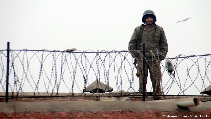 Soldier, barbed wire
