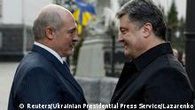 Ukrainian President Petro Poroshenko (R) welcomes his counterpart from Belarus Alexander Lukashenko during a meeting in Kiev, in this December 21, 2014 handout photo provided by the Ukrainian Presidential Press Service. REUTERS/Ukrainian Presidential Press Service/Mykola Lazarenko/Handout via Reuters (UKRAINE - Tags: POLITICS) ATTENTION EDITORS - THIS PICTURE WAS PROVIDED BY A THIRD PARTY. REUTERS IS UNABLE TO INDEPENDENTLY VERIFY THE AUTHENTICITY, CONTENT, LOCATION OR DATE OF THIS IMAGE. THIS PICTURE IS DISTRIBUTED EXACTLY AS RECEIVED BY REUTERS, AS A SERVICE TO CLIENTS. FOR EDITORIAL USE ONLY. NOT FOR SALE FOR MARKETING OR ADVERTISING CAMPAIGNS