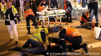 Rescue workers tending to victims after a driver deliberately slammed into passersby in several spots in Dijon