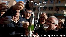 MADRID, SPAIN - DECEMBER 22: Alfonso (L), who has been unemployed for eight months, celebrates with his son Diego (2nd L) and friends after he won a top prize ticket number in Spain's Christmas lottery, 'El Gordo' (Fat One) on December 22, 2013 in Leganes, near Madrid, Spain. This year's winning number is 62246, with a total of 4 million euros for the top prize to be shared between ten ticket holders. The total prize fund is worth 2.5bn. (Photo by Pablo Blazquez Dominguez/Getty Images)